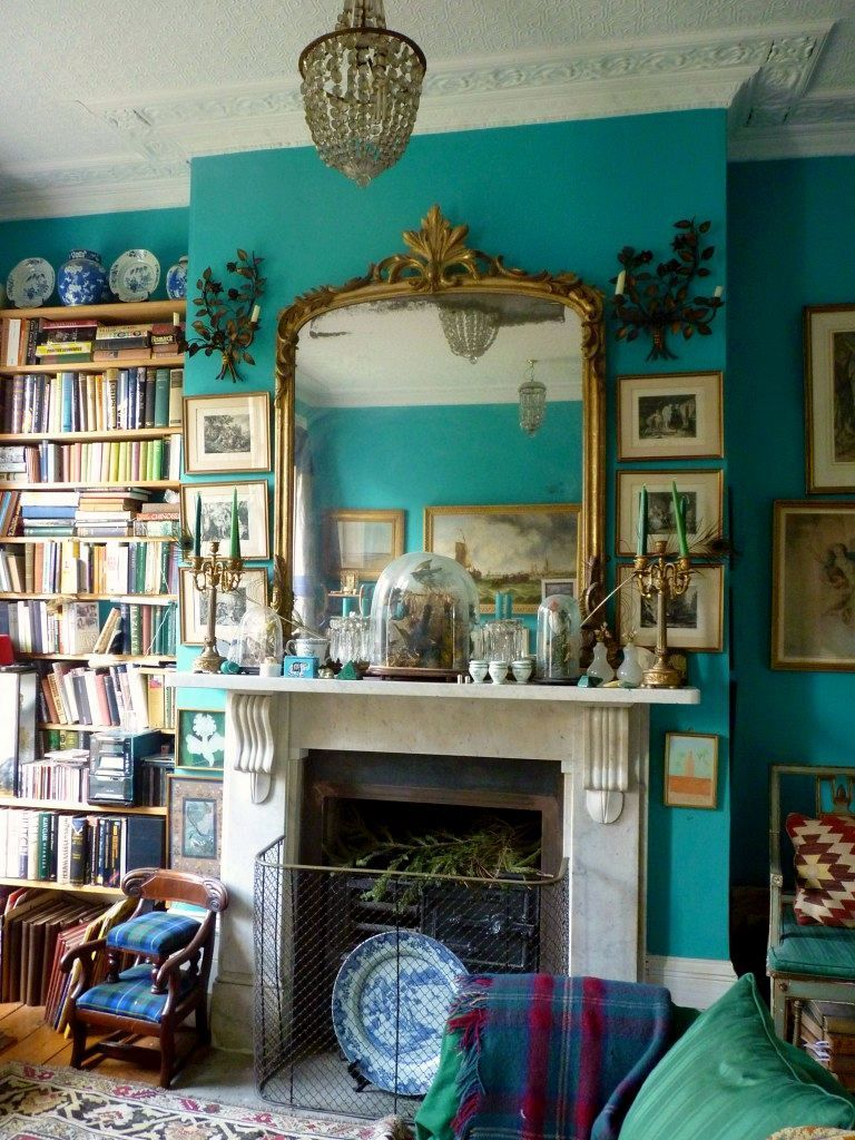 Enchanting Blue Painted Wall Decorated with Fireplace Mantel Decor and Gorgeous Wall Mirror