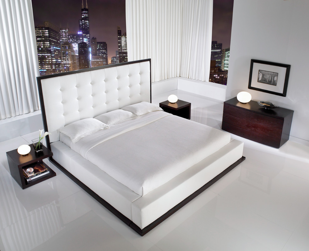 enjoy city night view from stylish bedroom with wide platform bed and small bedside table lamps - Bedroom Table Ideas