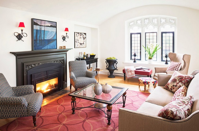 Fancy Interior Living Room with Red Area Rug also Fireplace Between Arm Chairs