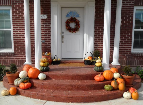 Fascinanting Brown Ramp for Nice Front Porch Decor with Cute Orange Pumpkin Picture