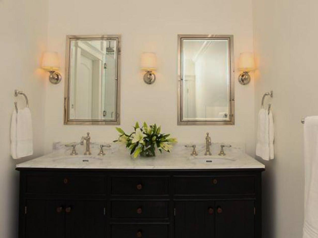 Fascinating Bathroom with Dark Bathroom Cabinet Ideas and White Marble Top under Glossy Framed Wall Mirrors