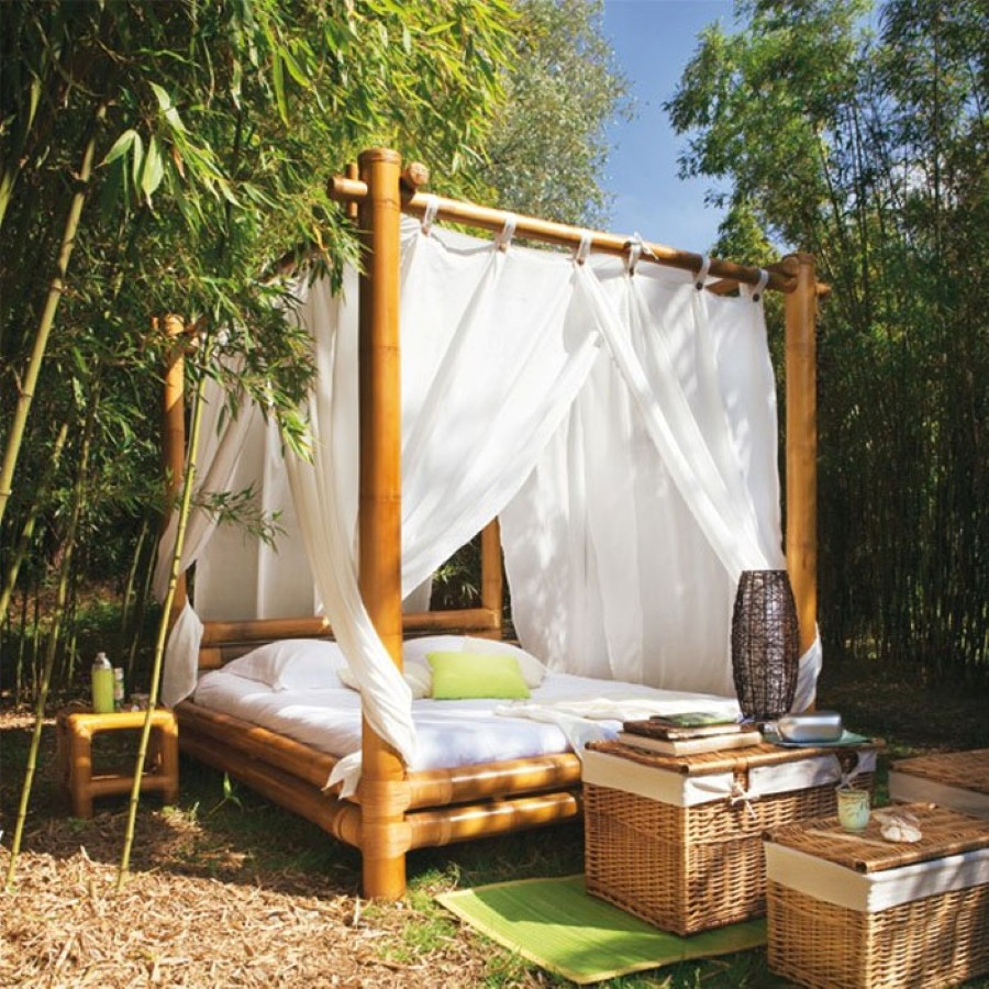 Feel Comfortable with Bamboo King Canopy Bed using White Bedding and Thick Curtain beside Bamboo Table