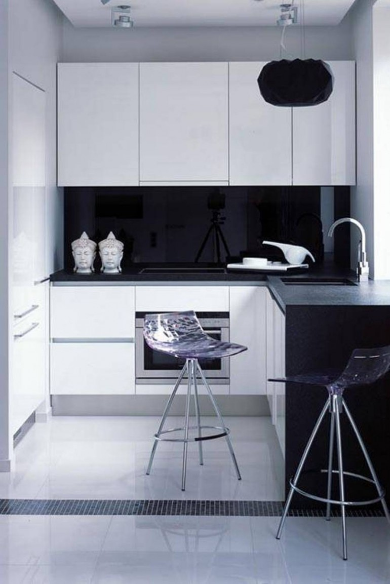 Fill Small Black and White Kitchen with White Cabinets and Black Countertop beside Modern Stools