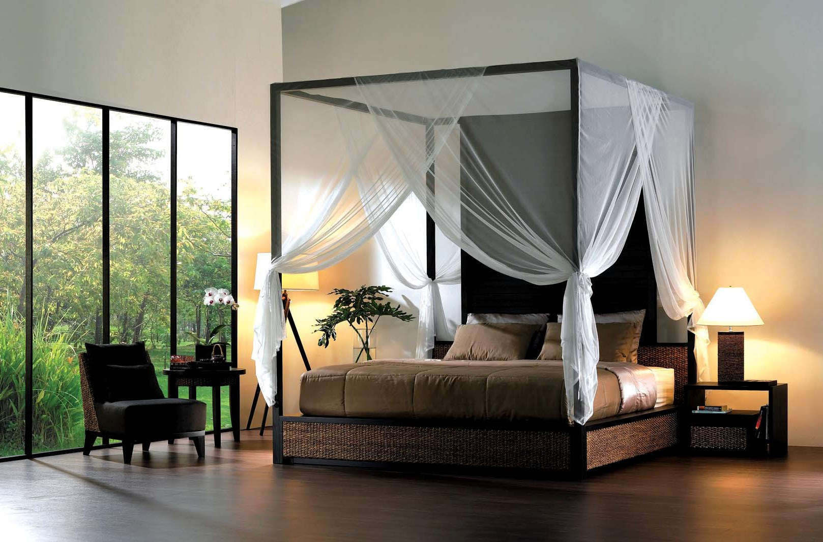 fill spacious bedroom with wide bed and sheer canopy bed curtains near