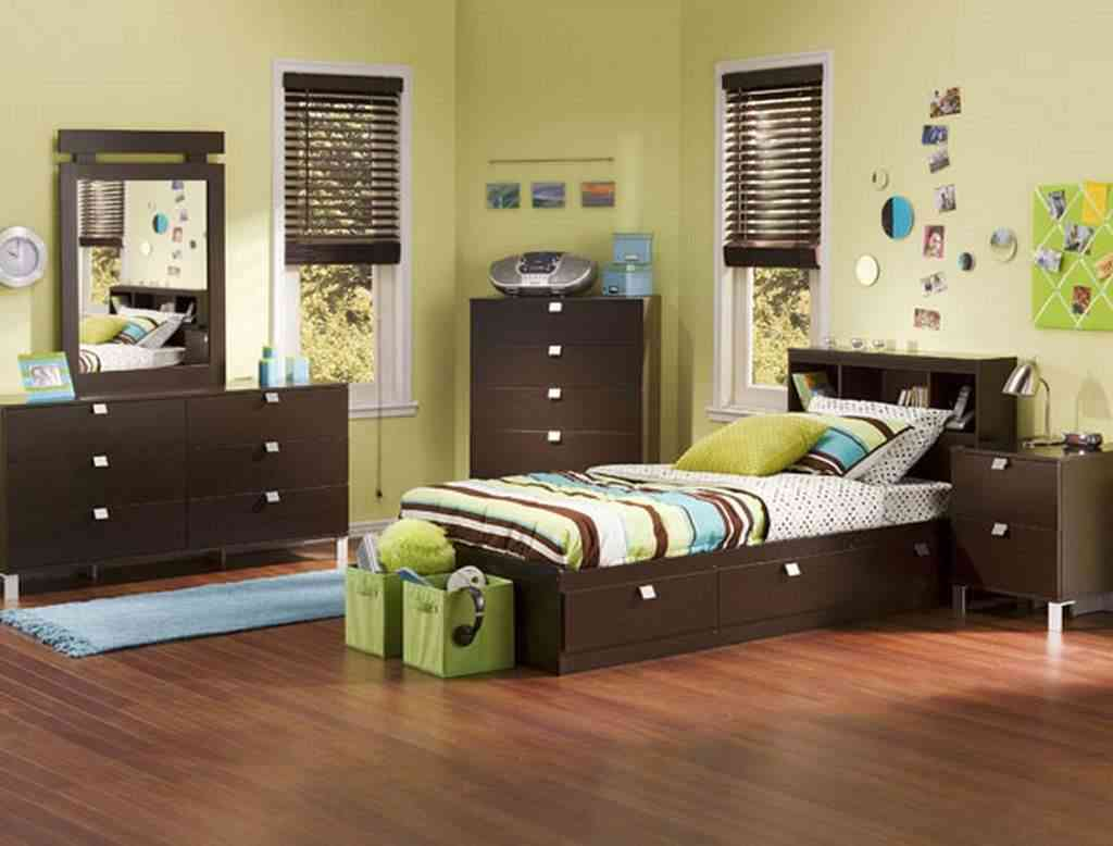 Fill Spacious Boys Bedroom using Simple Oak Furniture with Dark Dressers and Blue Carpet