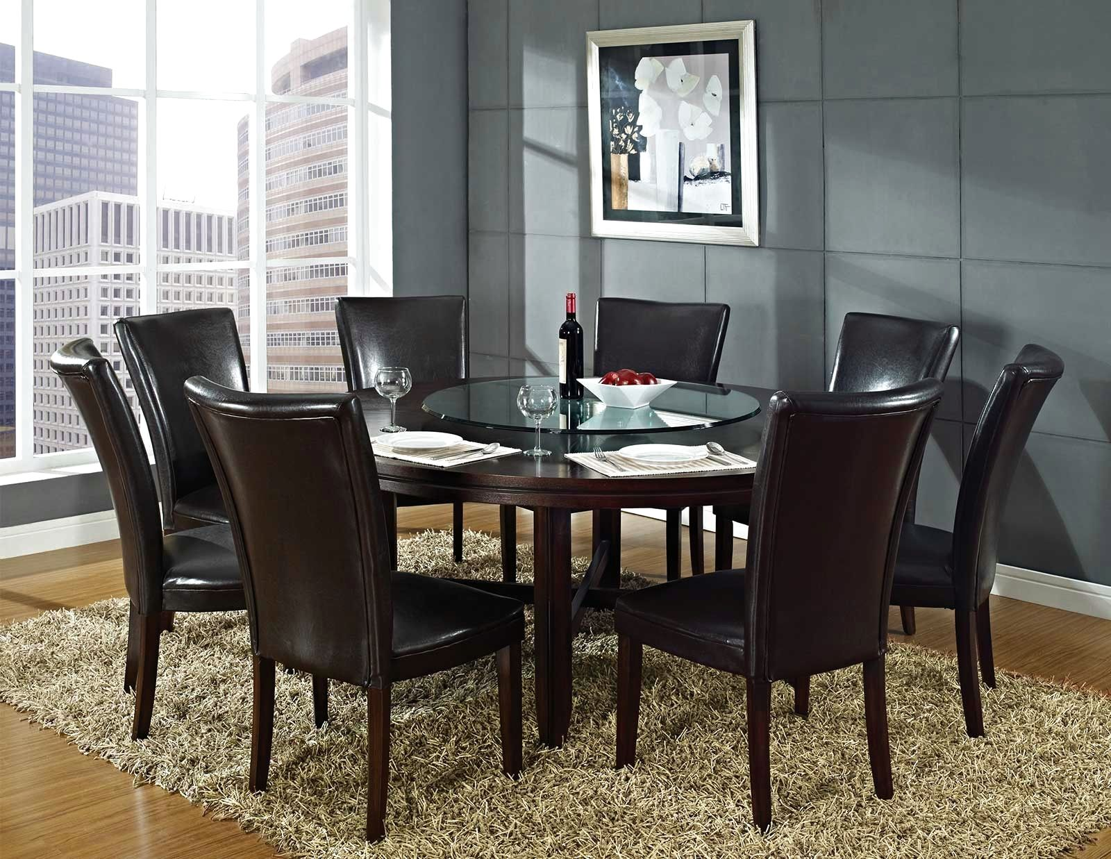 Formal round dining table for 6 completing cozy dining room with dark leather chairs on grey