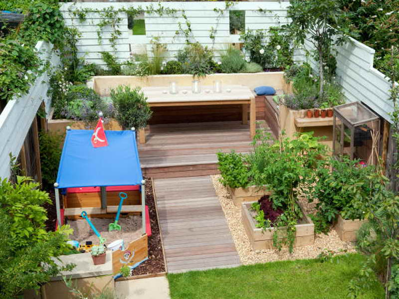 Fun Kids Sand Playroom and Wooden Bench for Small Backyard Ideas with Green Plantations