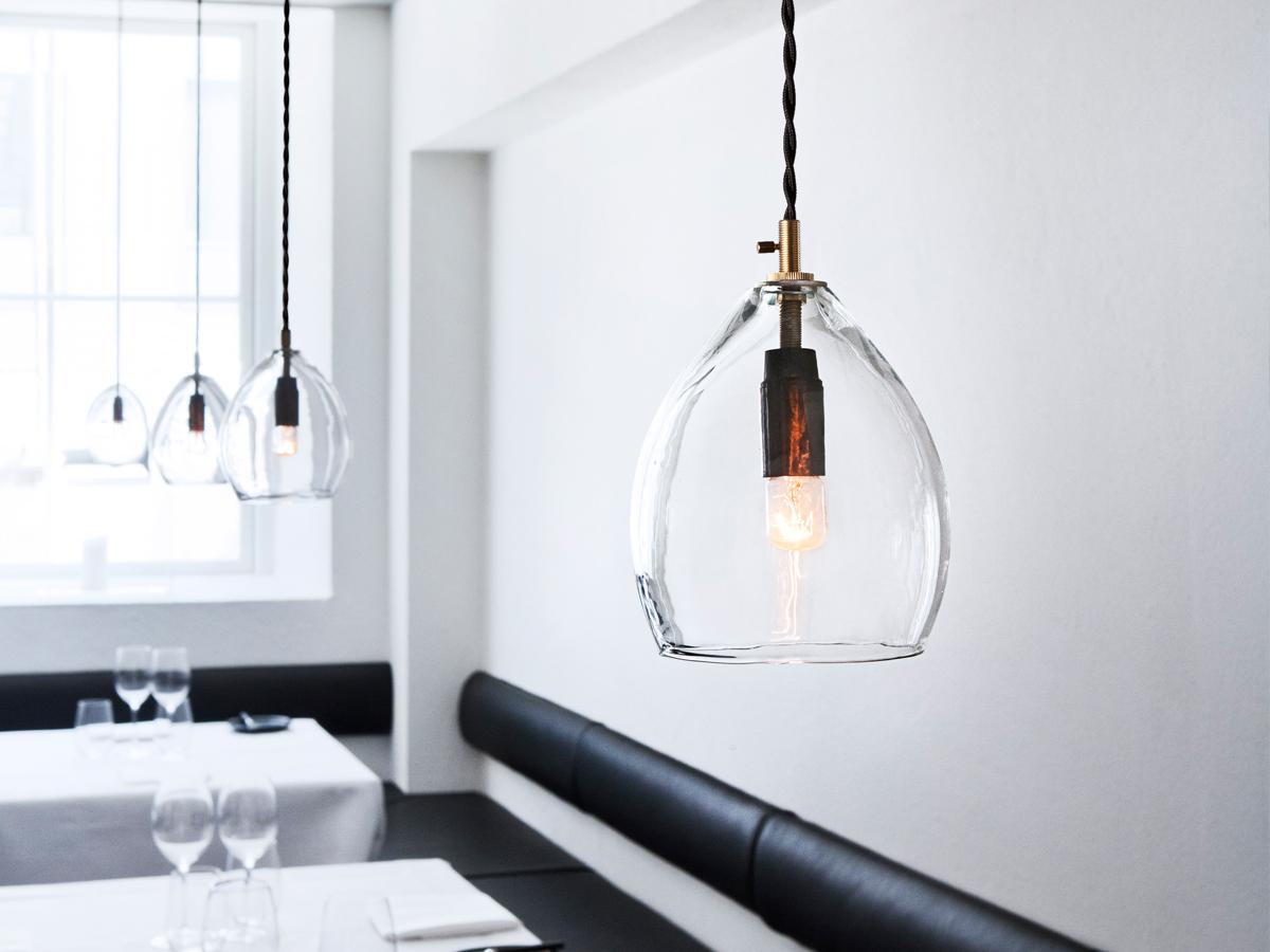 Glass Pendant Light Shades for Dining Space with Long Black Leather Benches and White Table