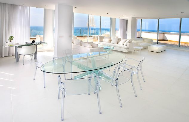 Glossy Ambience from Best Oval Glass Coffee Table with Sleeky Surface plus White Floor