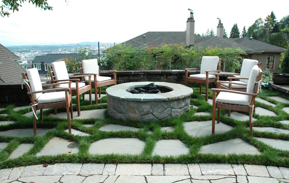 Green Grass and Stone Pathway Decorating Cozy Patio with Stone Fire Pit Designs and Wooden Chairs