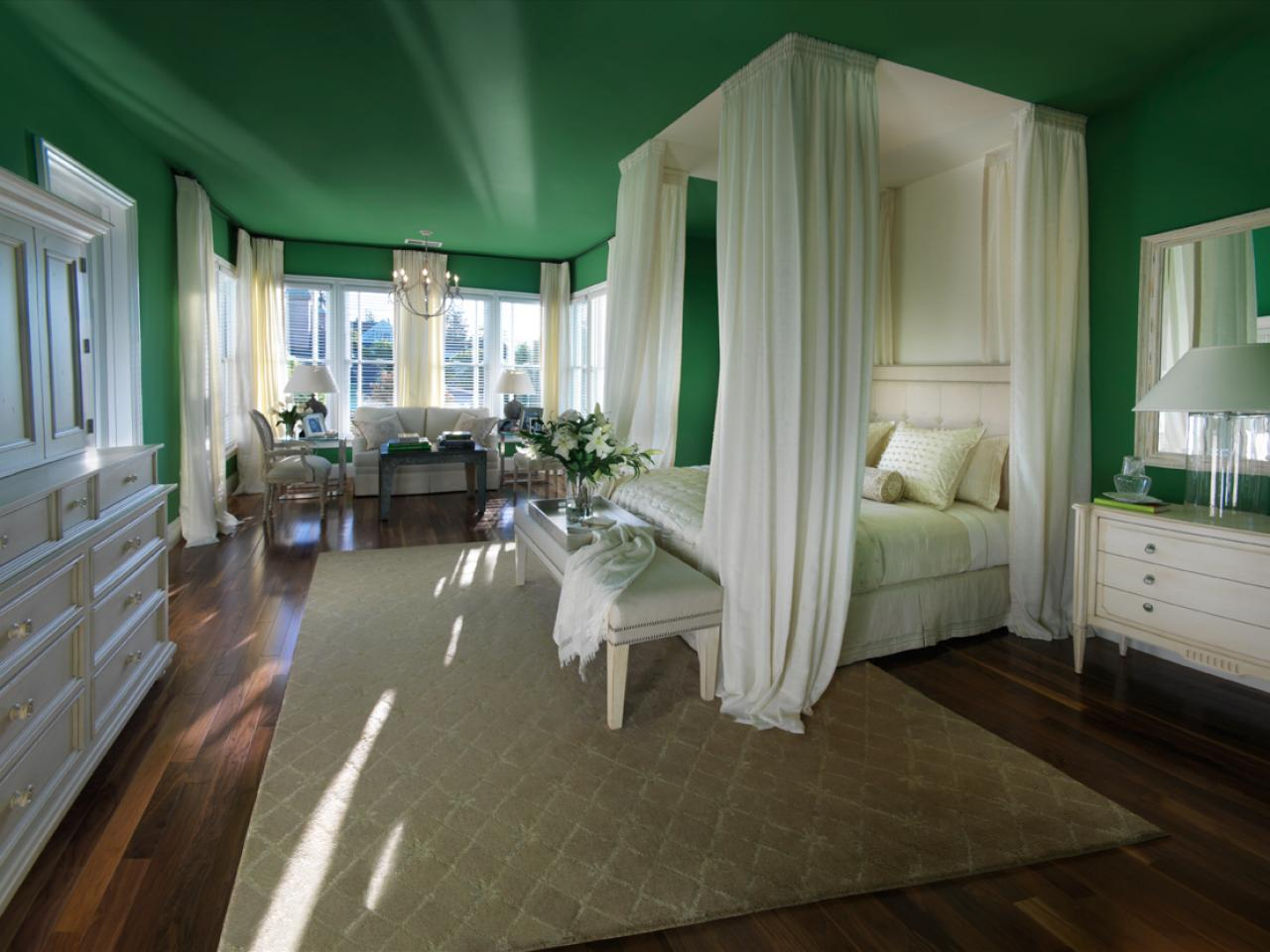 Green Painted Wall and Ceiling Completing Elegant Bedroom with White DIY Canopy Bed and Long Bench