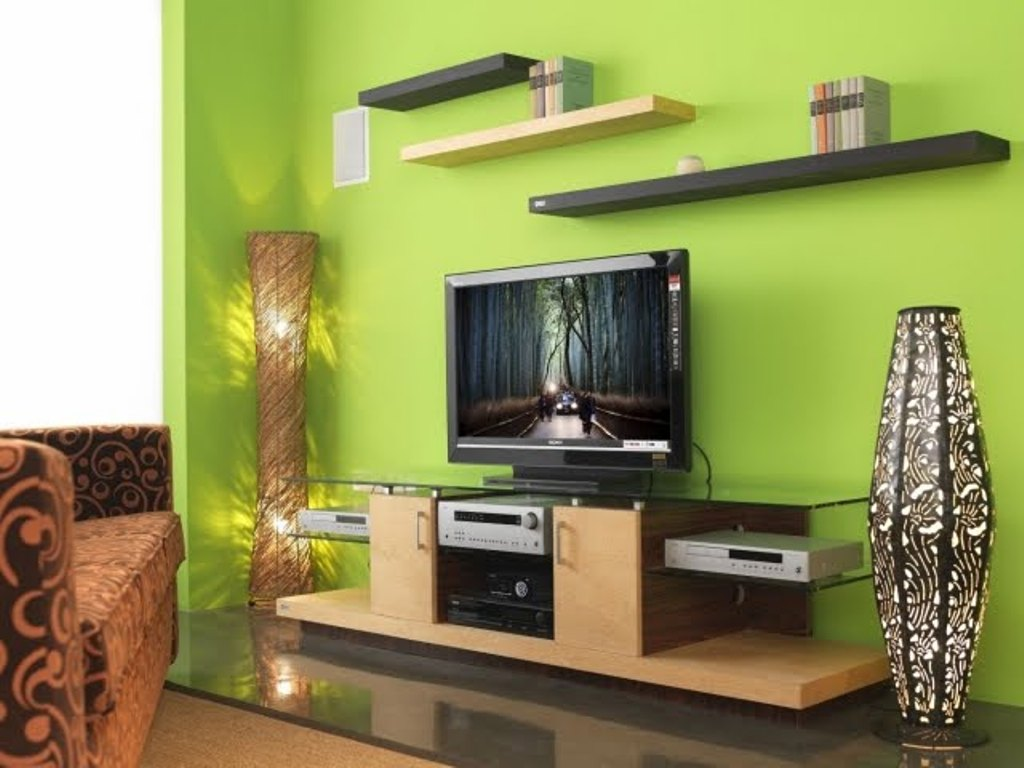 Green Painted Wall for Stunning Family Room Design Ideas with Glass Top TV Cabinet