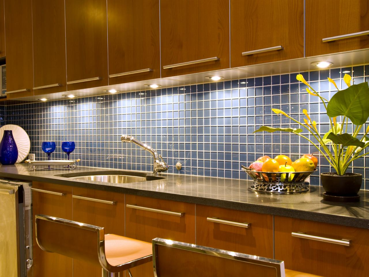 Grey Kitchen Tile Ideas Illuminated with Bright Lights inside Stylish Kitchen using Teak Counter