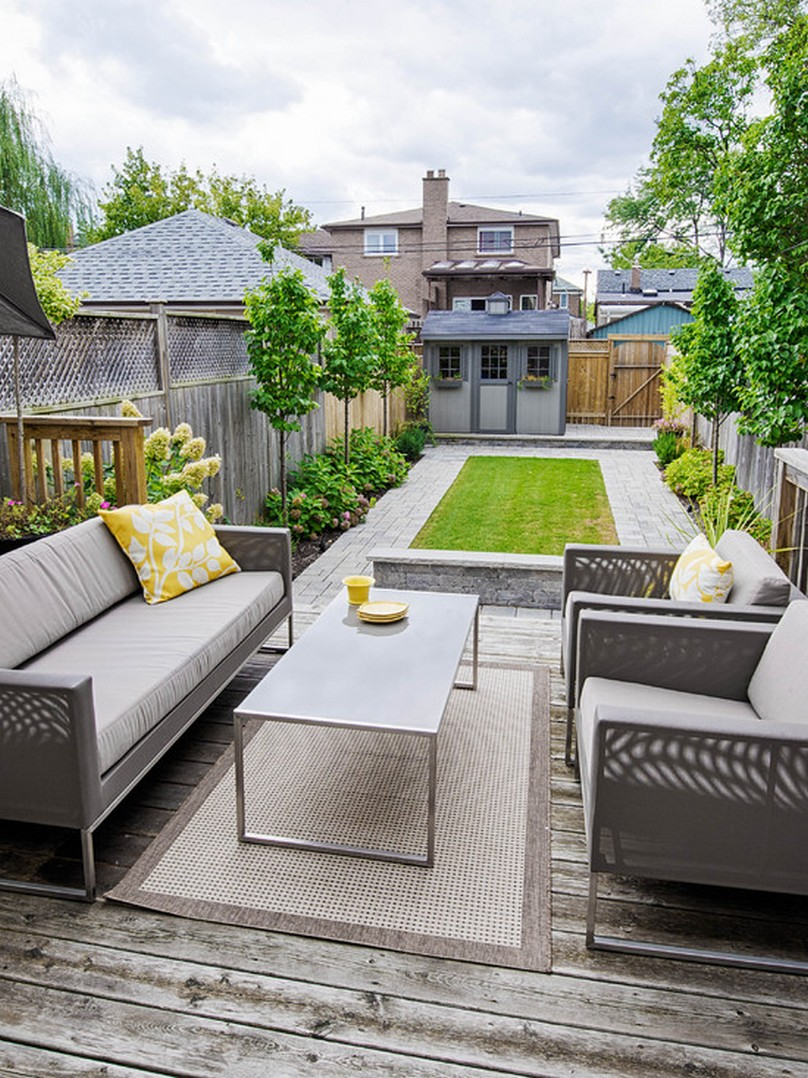 Grey Sofas and Long Table on Old Fashioned Wooden Deck inside Small Backyard Ideas with Grass Area