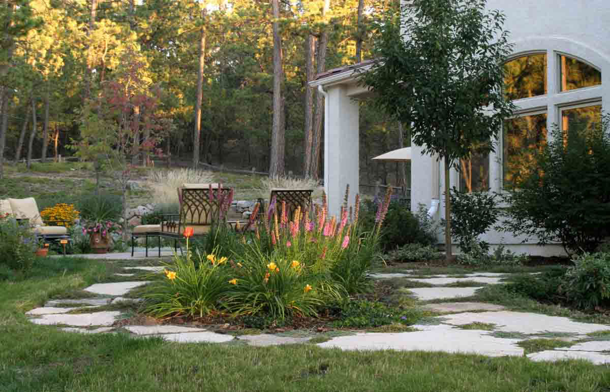 High Trees around Backyard Landscape Design with Cozy Furniture closed Stone Steps