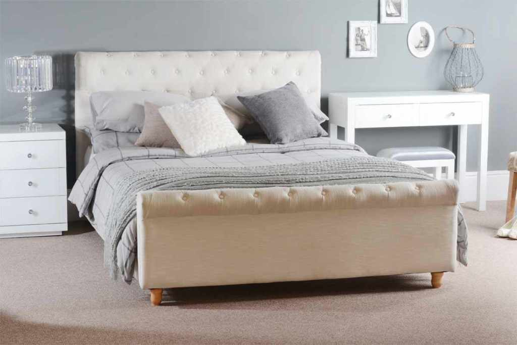 Innovative Tufted Bed and Grey Bedding between Small White Side Table and Console Table