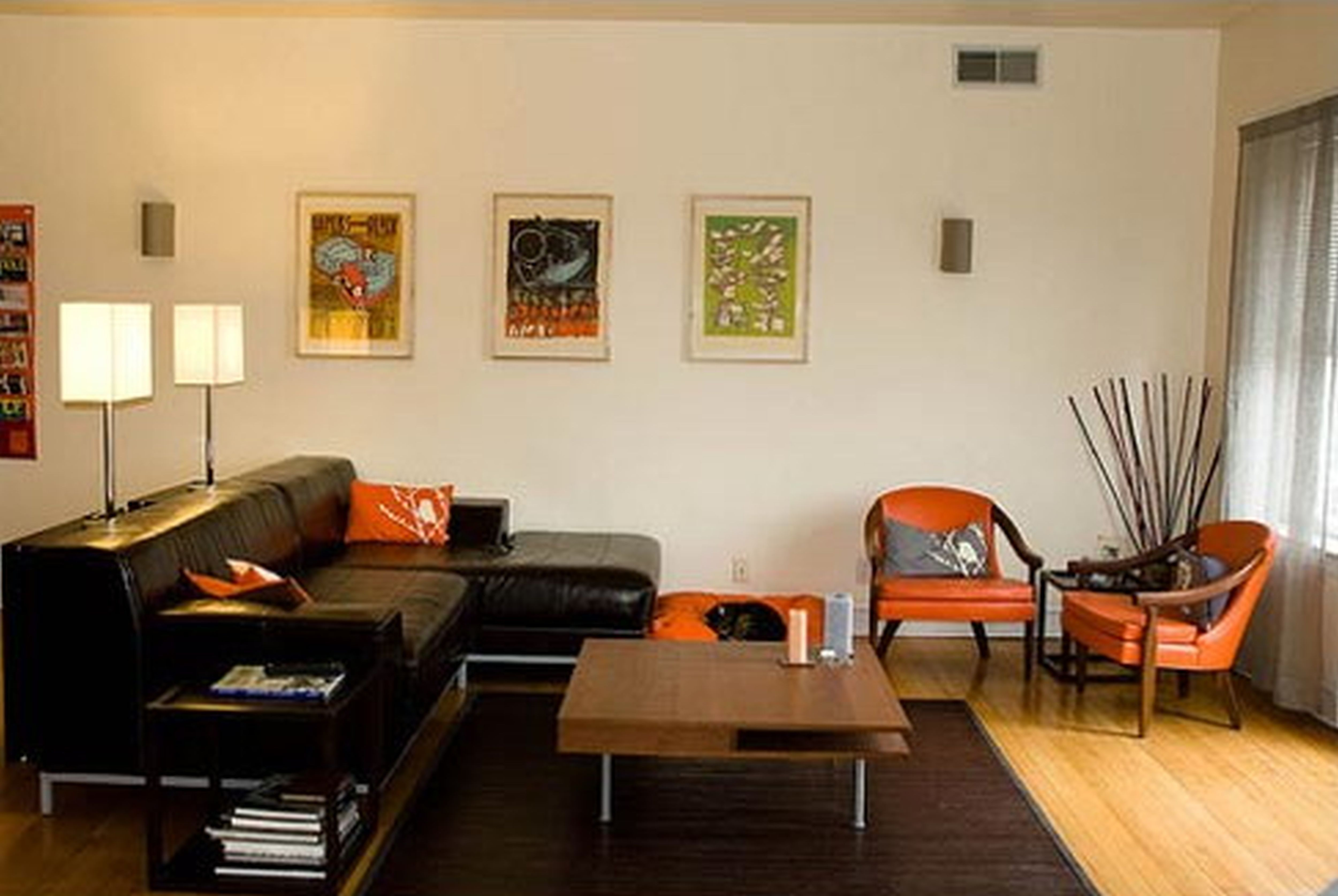 Innovative Wall Arts Decorating Living Room in Small Apartment Ideas with Black Sectional Sofa