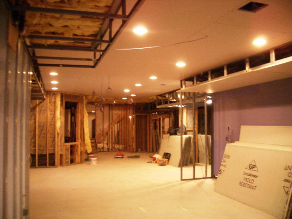 Install Bright Lamps on Minimalist Basement Ceiling Ideas for Spacious Room with Cream Flooring