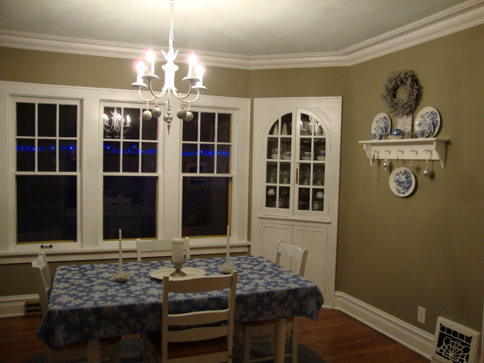 Install Small Chandelier above White Dining Table and Chairs near Old Fashioned Dining Room Wall Decor