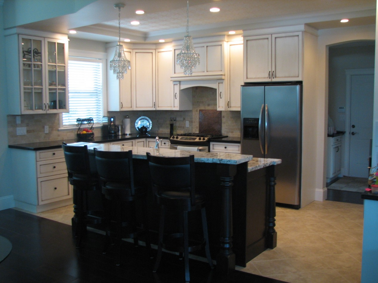 Install Small Crystal Chandeliers above Black Kitchen Island Plans and Stools for Open Kitchen Area