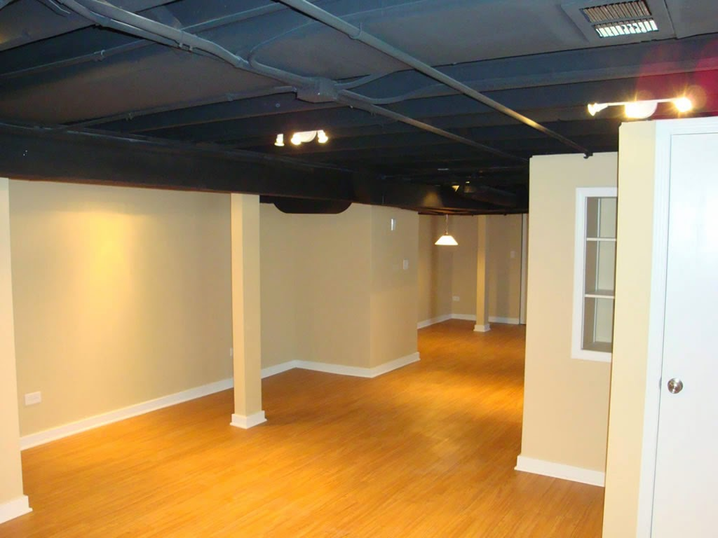 Interesting Dark Basement Ceiling Ideas in Cozy Room with Cream Painted Wall and Laminate Oak Flooring