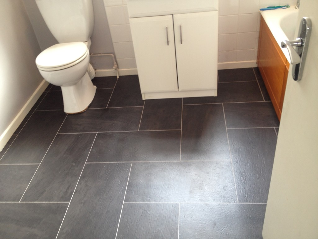 Interesting Dark Grey Bathroom Floor Tile for Small Room with White Vanity and Cozy Bathtub