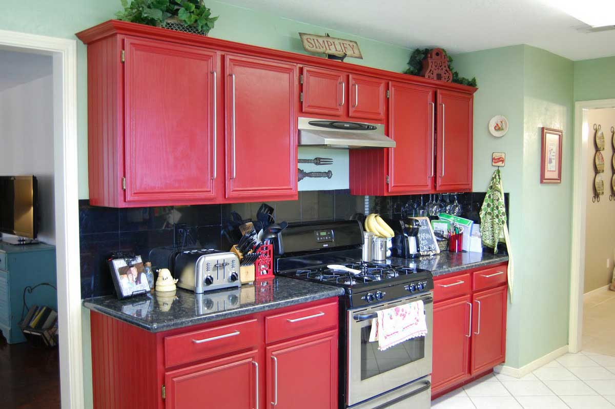 Interesting Furniture Using Red Kitchen Cabinets also Black Countertop and Backsplash