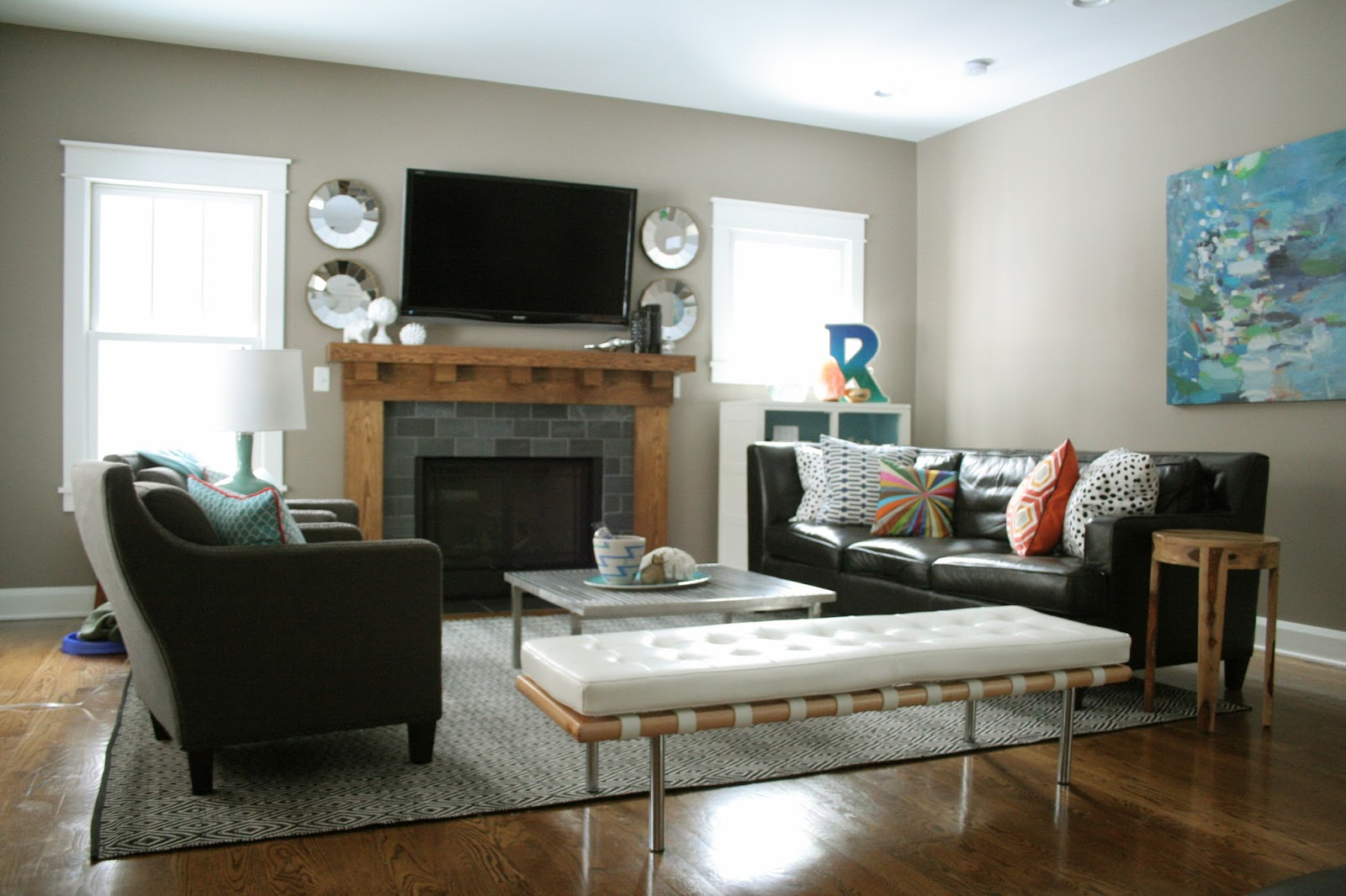 Interesting Living Room Layout with Dark Sofas and Wide Coffee Table on Grey Carpet
