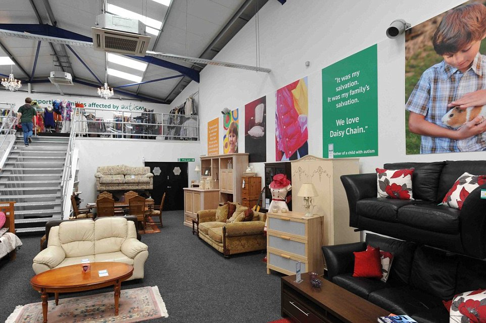 Interesting Showroom for Awesome Second Hand Furniture with Black Leather sofas and Wooden Coffee Tables