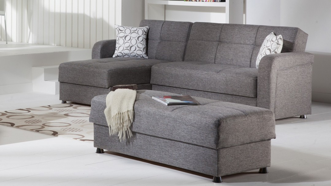Long Grey Bench and Sofa Bed Mattress Placed inside Wide Sitting Room with Tile Flooring