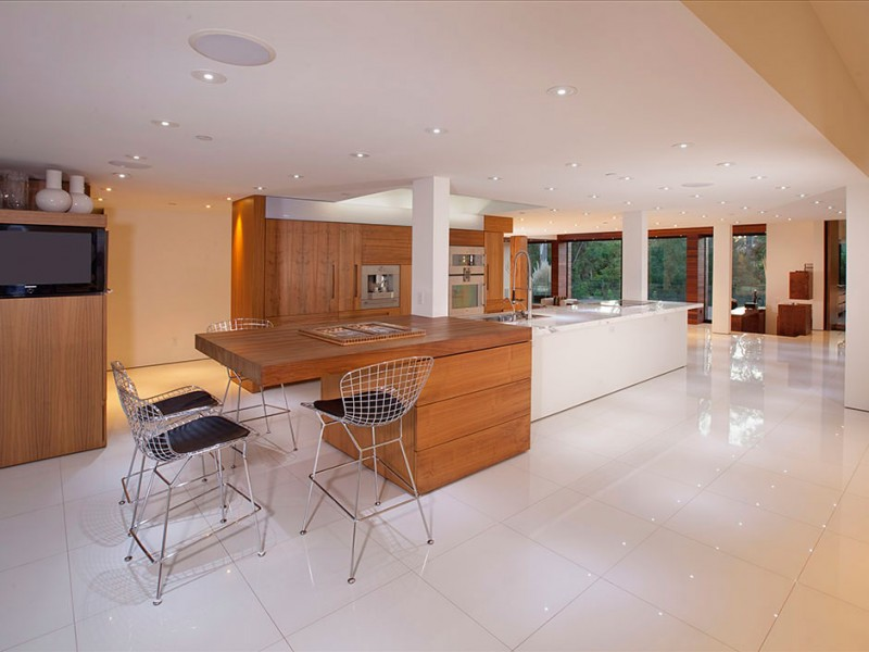 Long White Island and Metal Stools on White Kitchen Floor Tile inside Fascinating Open Kitchen