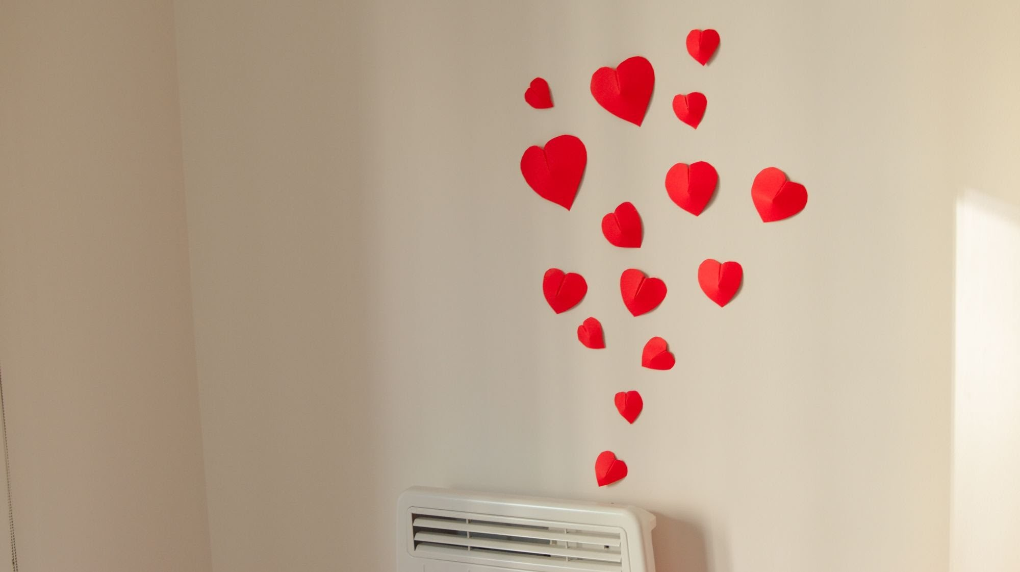 Lovely Red Hearts as Enchanting Wall Decoration Ideas on White Painted Wall in Minimalist Room