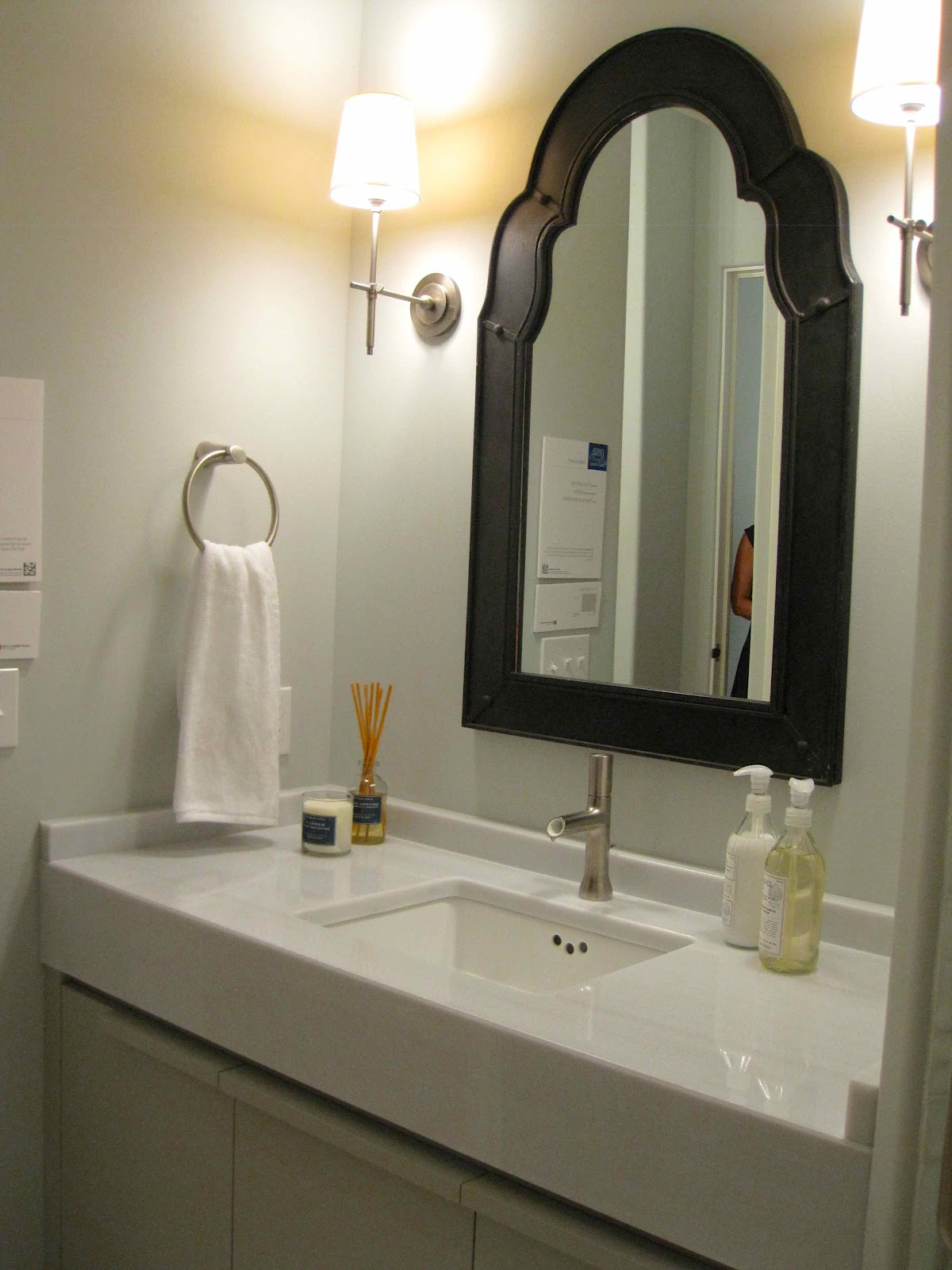 Luxurious Vanity With Sink also Mirror Between Nice Wall Lamps