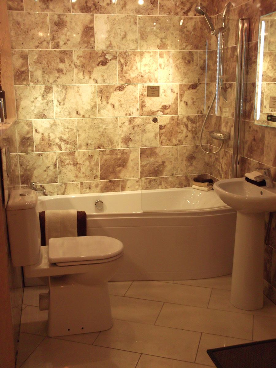 Small bathroom space saver ideas midcityeast Smallest bath tub