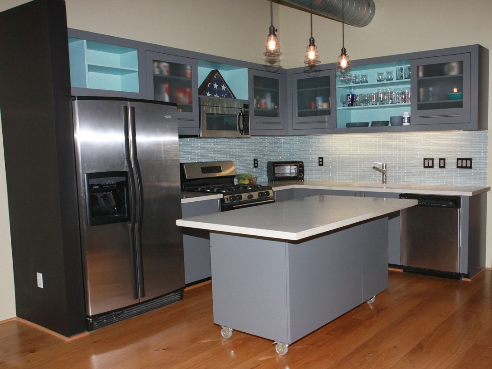 Metal Kitchen Cabinets And Grey Island Completing Open Small Kitchen On Hardwood Flooring