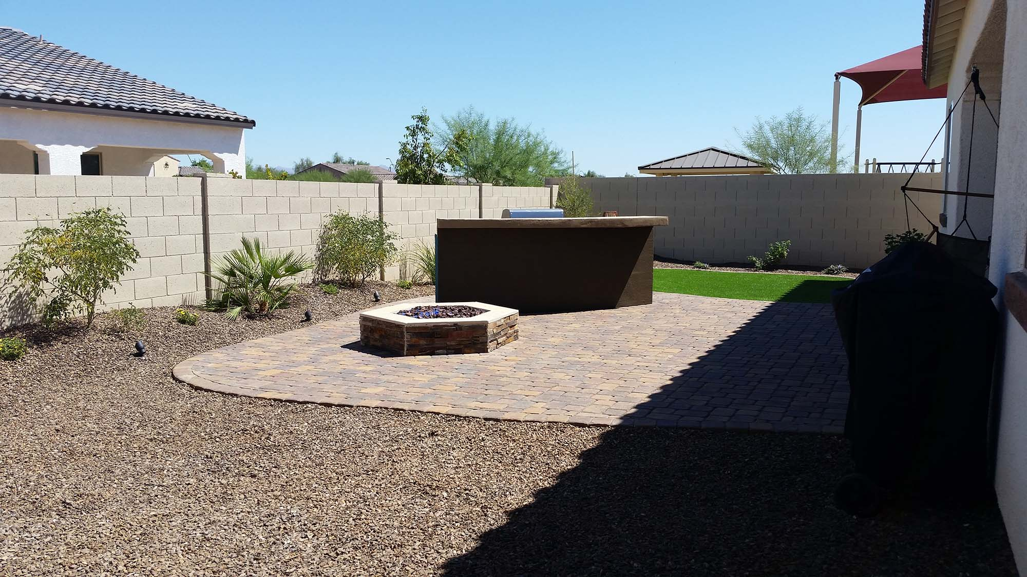 Minimalist Low Fire Pit on Amusing Concrete in Backyard Landscape with Nice Tile Fence