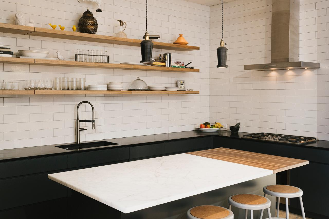 Modern black and white kitchen with wooden floating shelving