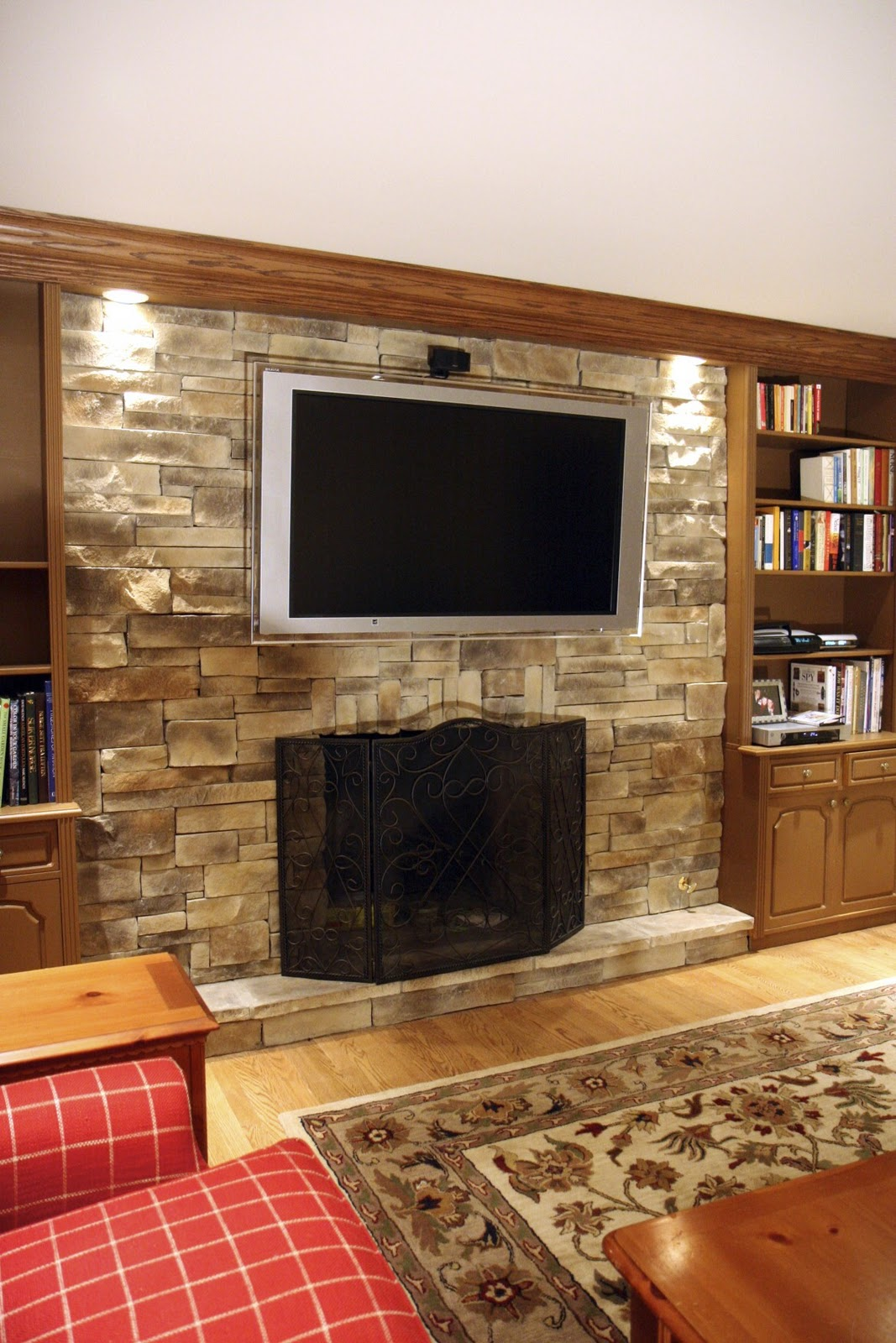 Modern Dark Fireplace Decor Ideas with Slim Iron Element close Great Stone Wall