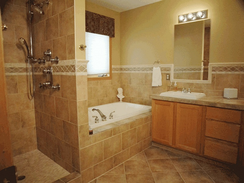 Natural Oak Vanity and White Bathtub Placed near Old Fashioned Shower Area with Cream Tile Shower Ideas
