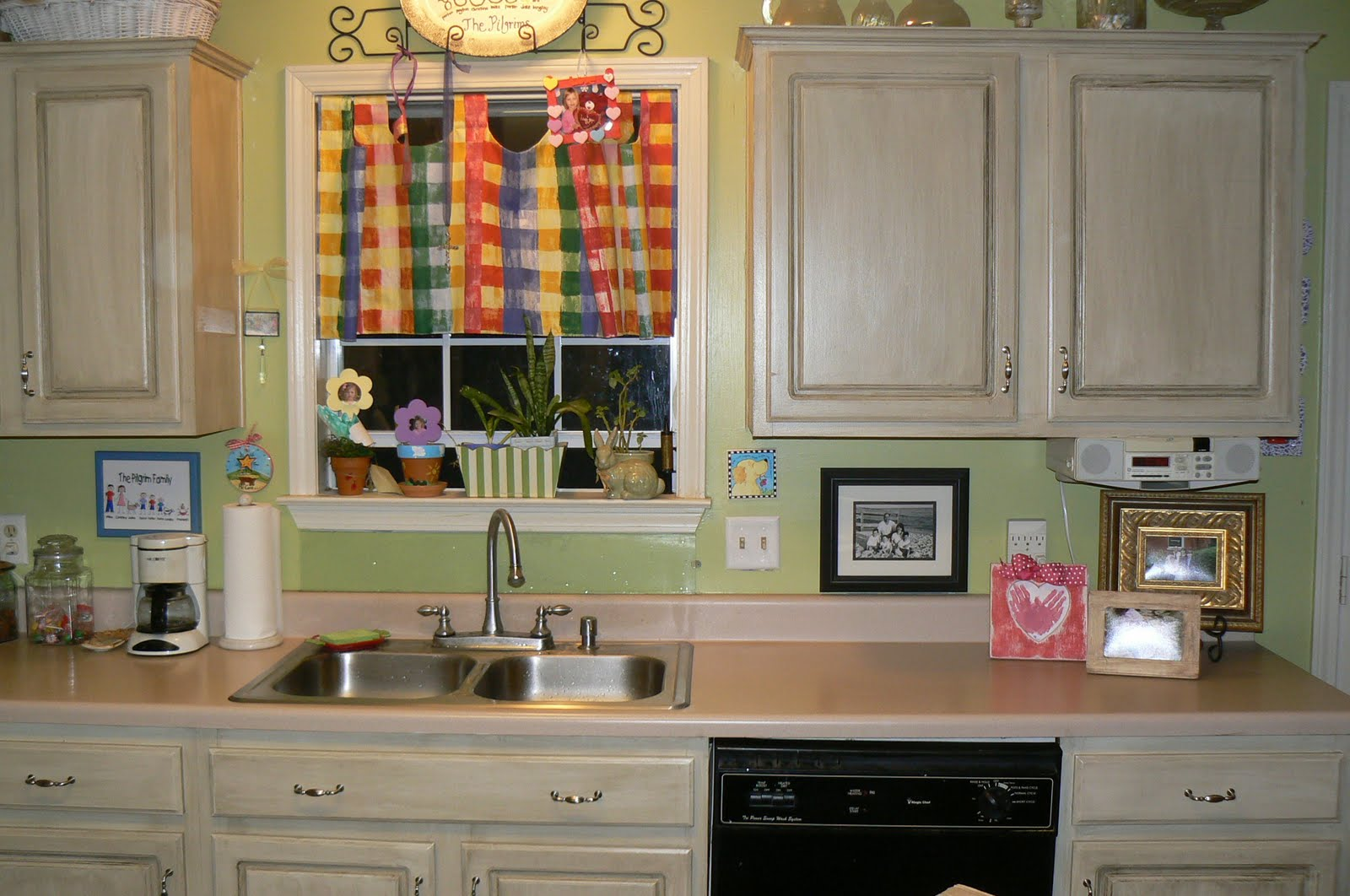 Old Fashioned Paint Kitchen Cabinets and Glossy Sink under Colorful Window Blind unde Bright Light