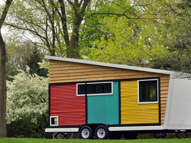Opulent Container House With Colorful Wall Paint also Small Tires