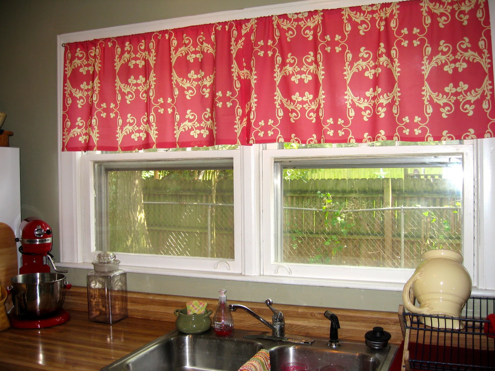 Pink Kitchen Window Curtains For Old Fashioned White Framed Windows Above Long Counter