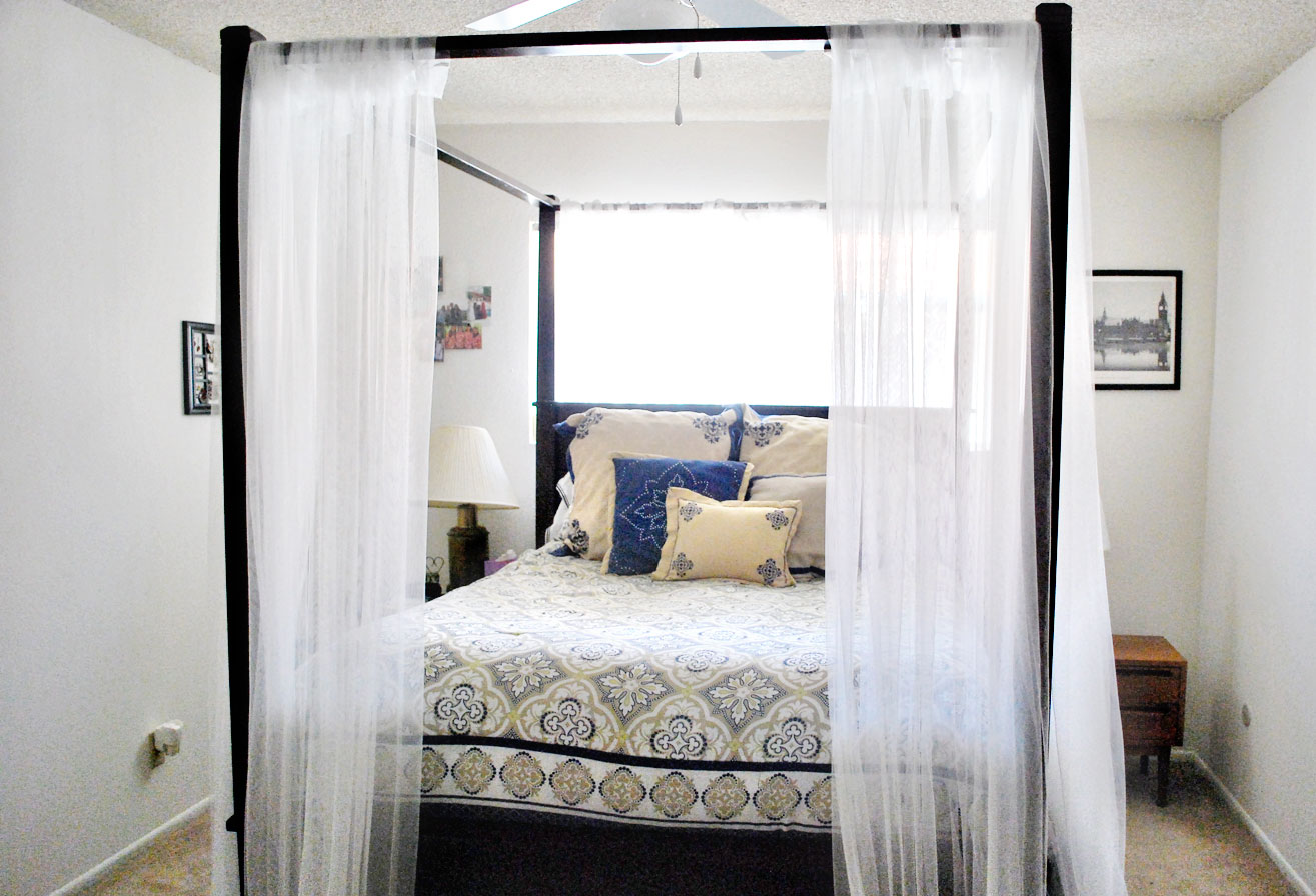 appealing wooden bed and white canopy bed curtains in small bedroom