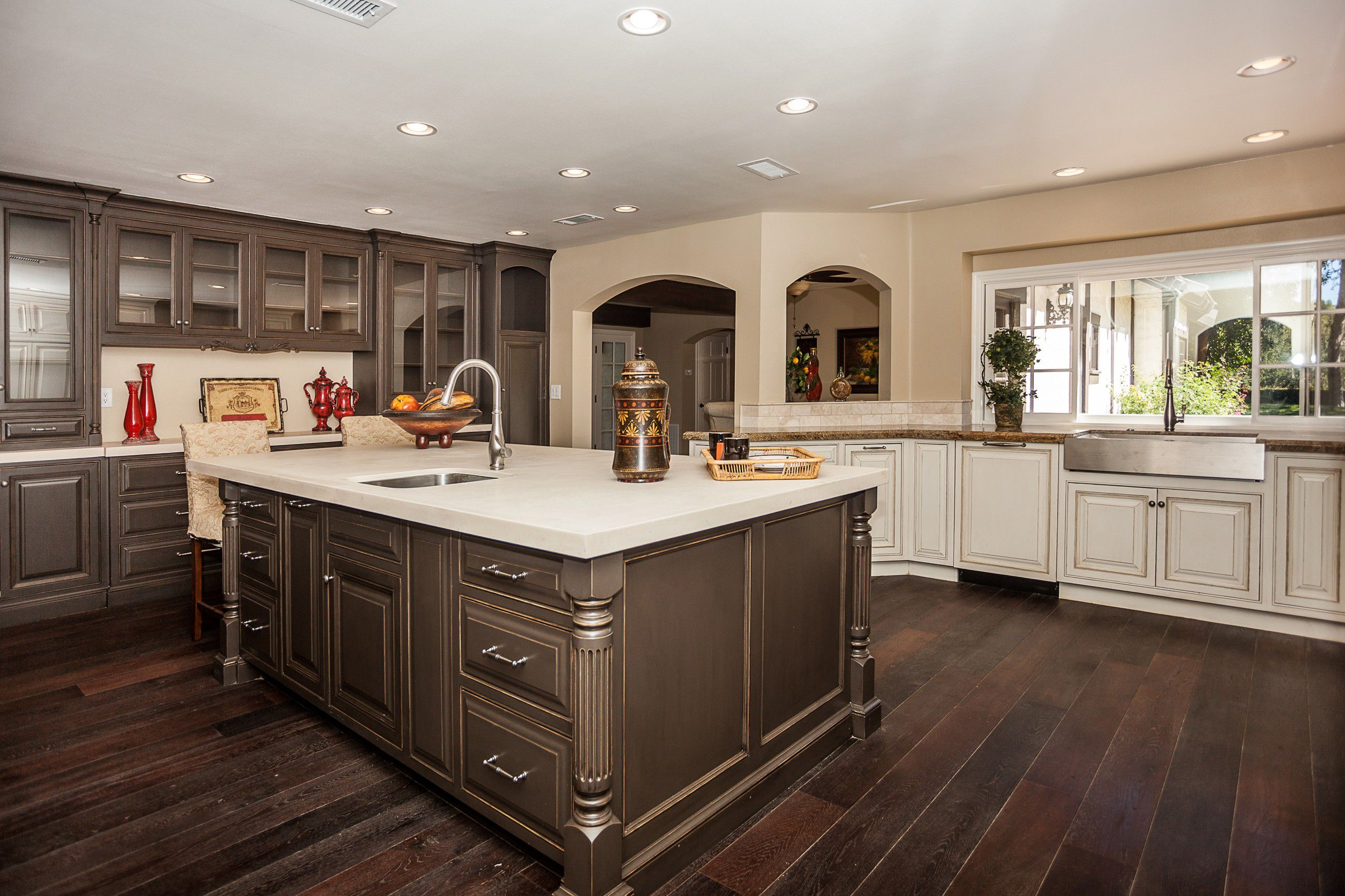 Place Artistic Island in Spacious Kitchen using Classic Paint Kitchen Cabinets and White Framed Windows