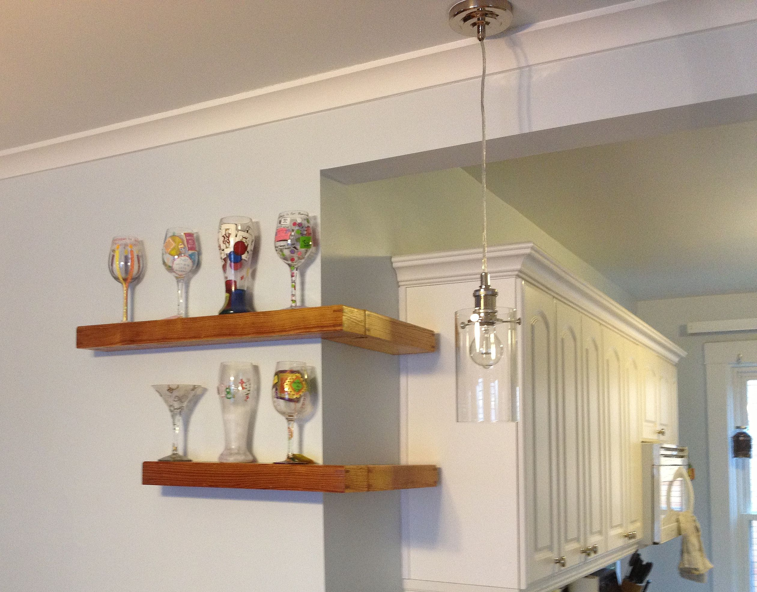 Place Enchanting Glasses on Natural Oak Floating Corner Shelves for Old Fashioned Room with White Wall