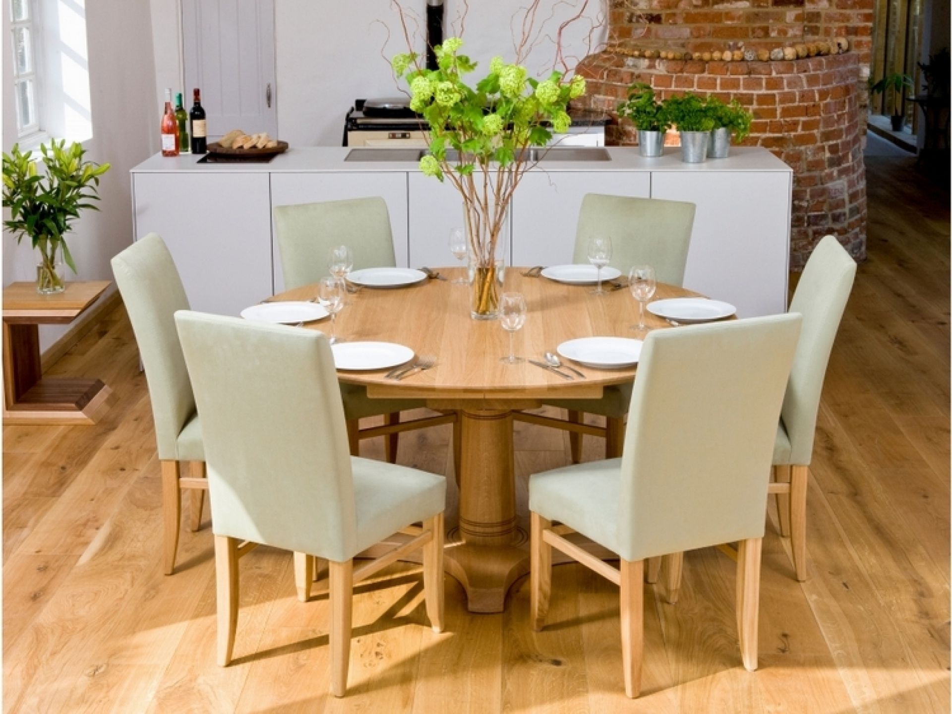 Place Grey Lather Chairs And Round Dining Table For 6 In Minimalist Room On Laminate