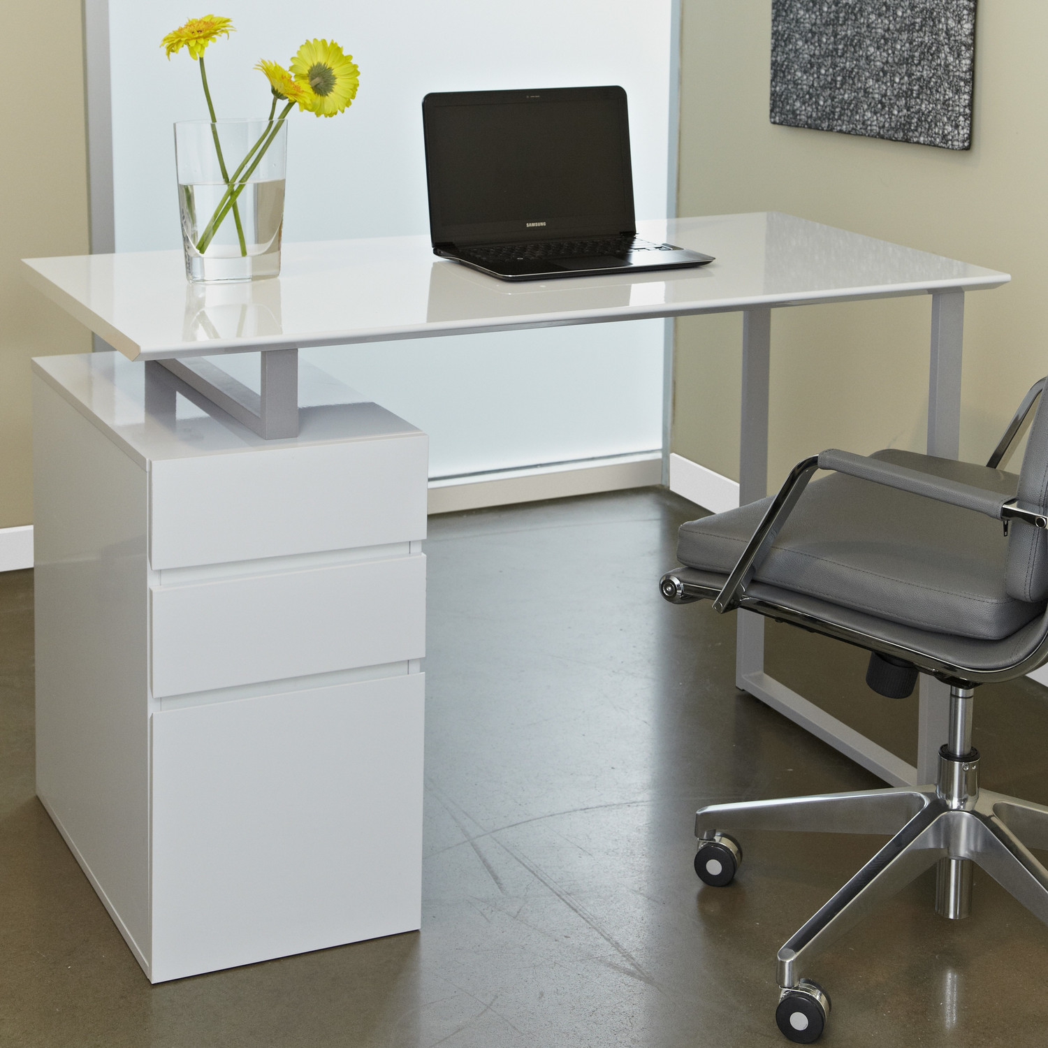 Place Grey Swivel Chair and White Desk with Drawers Completing Stunning Home Office with Concrete Flooring
