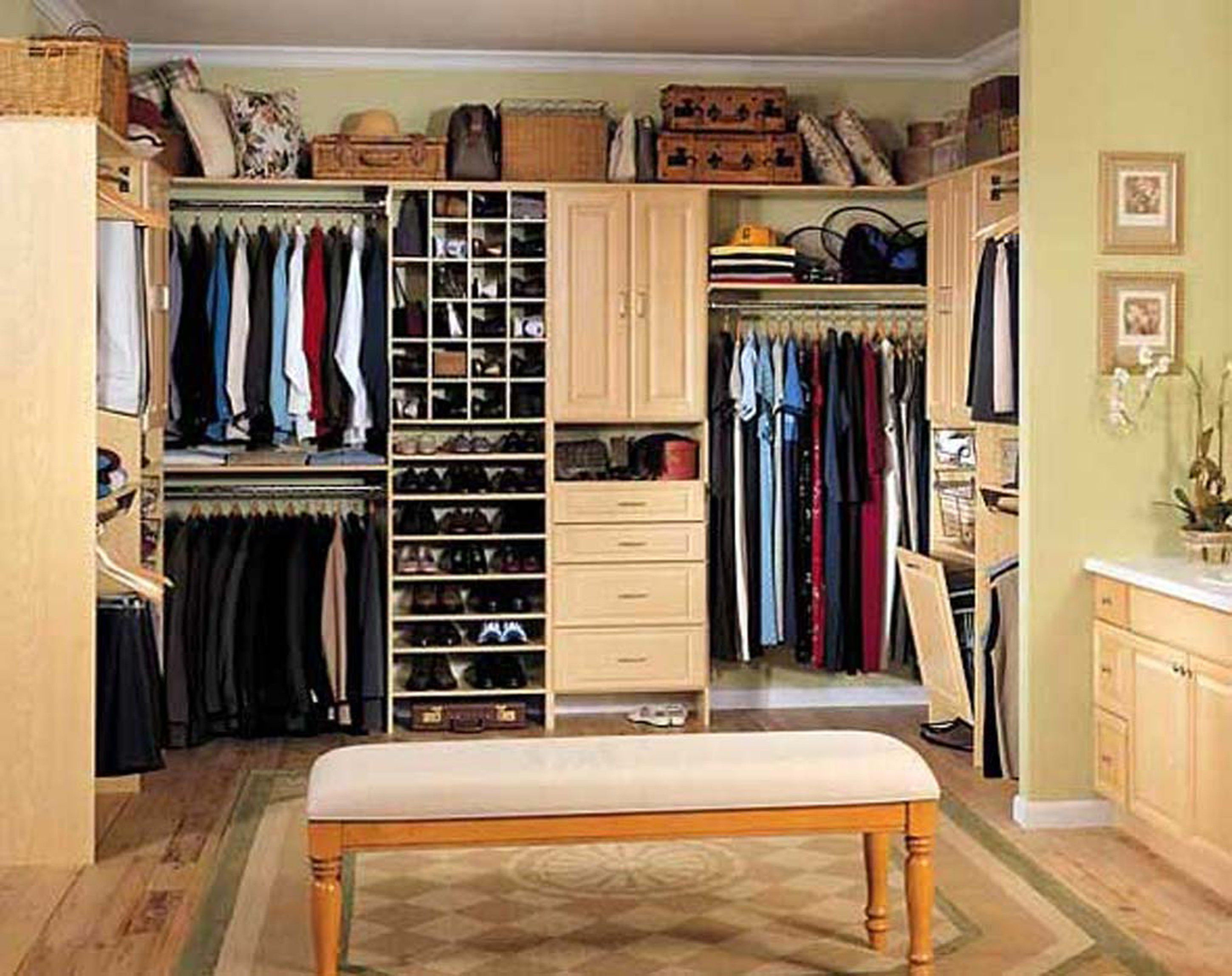 Place Long Bench in Wide Walk In Closed using Tidy Closet Storage Ideas with Shoes Shelves and Clothes Hangers
