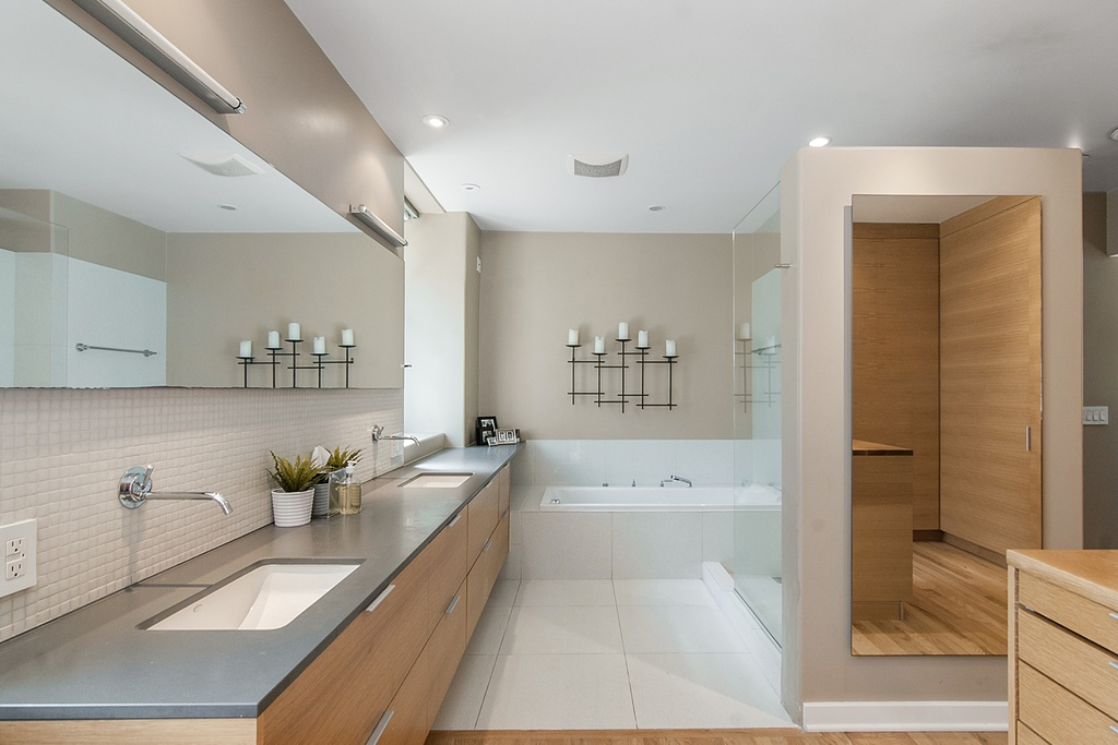 Place Long Oak Vanity And White Sinks Inside Modern Bathroom Design With White Bathtub