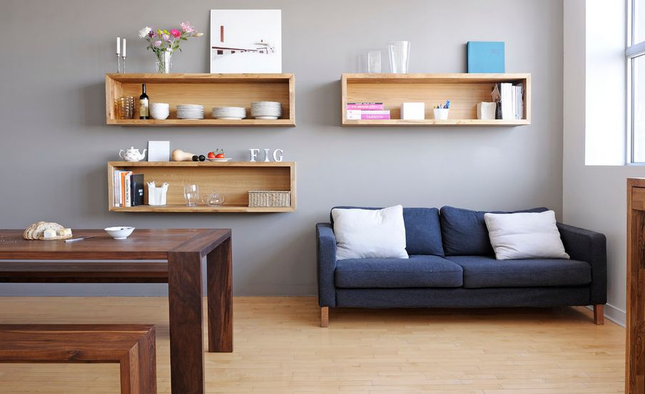 Place Oak Wall Mounted Shelves in Dining Sitting Room with Blue Sofa and Wooden Dining Table